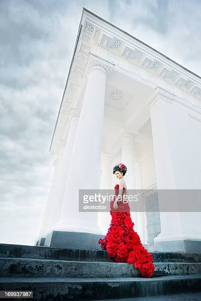 Renaissance woman at the steps of white columned building