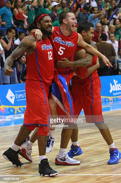 Renaldo Balkman and Jose Barea of Puerto Rico celebrate during the Men's Basketball final match between Mexico and Puerto Rico in the 2011 XVI Pan...