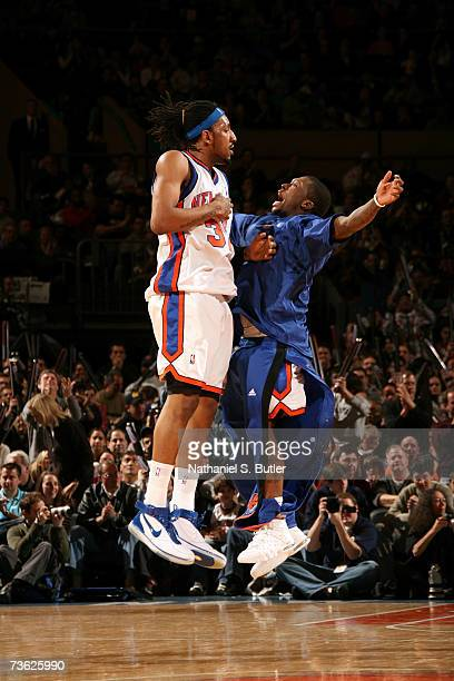 Renaldo Balkman of the New York Knicks chest bumps teammate Nate Robinson against the Toronto Raptors on March 18 2007 at Madison Square Garden in...