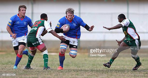 Renaldo Bothma of Namibia breaks with the ball during the Rugby World Cup 2015 qualifying match between Madagascar and Namibia at the Mahamasina...