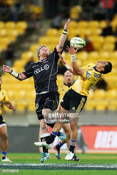 Renaldo Bothma of the Sharks and Chris Smylie of the Hurricanes compete for a high ball during the round 13 Super Rugby match between the Hurricanes...