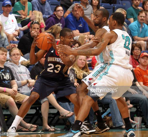 Renaldo Major from the Bakersfield Jam looks for help out of a double team from Yemi Ogunoye and Anthony Mason from the Sioux Falls Skyforce in the...