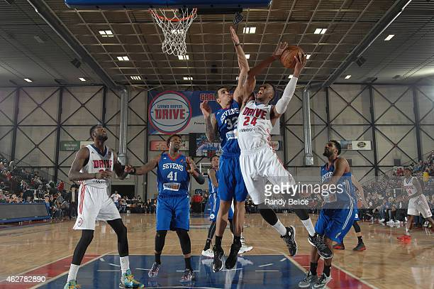 Renaldo Woolridge of the Grand Rapids Drive goes to the basket over Drew Gordon of the Delaware 87ers during the NBA DLeague game on January 31 2015...