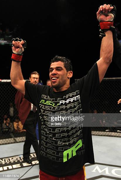 Renan Barao celebrates his unanimous decision victory over Cole Escovedo during their bantamweight fight at UFC 130 at the MGM Grand Garden Arena on...