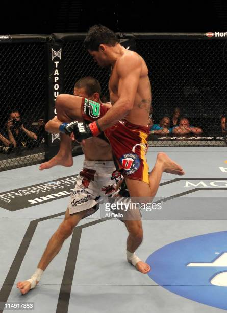 Renan Barao fires a flying knee at Cole Escovedo during their bantamweight fight at UFC 130 at the MGM Grand Garden Arena on May 28, 2011 in Las...