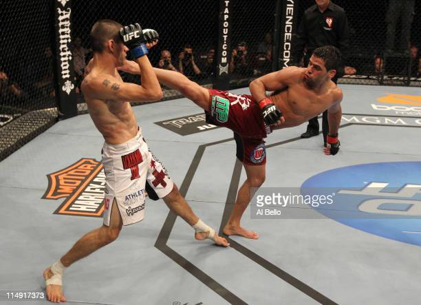 Renan Barao kicks Cole Escovedo during their bantamweight fight at UFC 130 at the MGM Grand Garden Arena on May 28, 2011 in Las Vegas, Nevada.