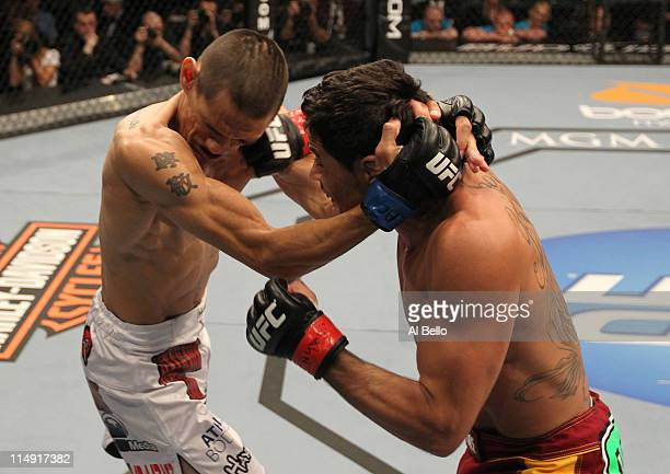 Renan Barao punches Cole Escovedo during their bantamweight fight at UFC 130 at the MGM Grand Garden Arena on May 28, 2011 in Las Vegas, Nevada.