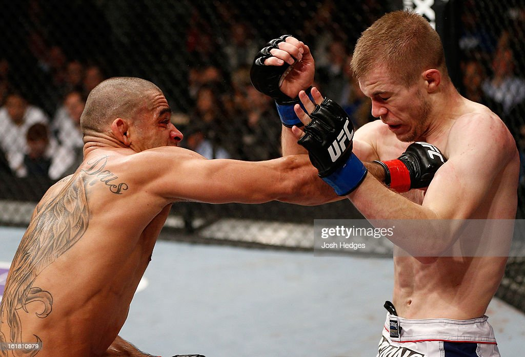 Renan Barao punches Michael McDonald in their interim bantamweight title fight during the UFC on Fuel TV event on February 16, 2013 at Wembley Arena in London, England.