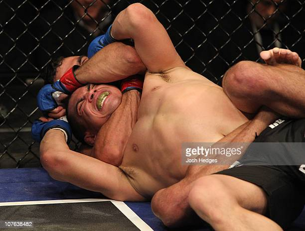 Renan Barao secures a rear naked choke submission to defeat Chris Cariaso at WEC 53 at the Jobingcom Arena on December 16 2010 in Glendale Arizona