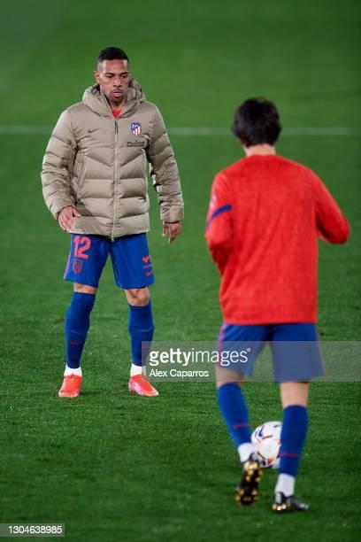 Renan Lodi and Joao Felix warm up during half time during the La Liga Santander match between Villarreal CF and Atletico de Madrid at Estadio de la...
