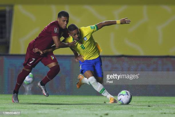 Renan Lodi fights for the ball with Darwin Machis of Venezuela fights for the ball with during a match between Brazil and Venezuela as part of South...