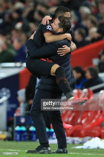 Renan Lodi of Atletico and coach Diego Simeone celebrate their 2nd goal during the UEFA Champions League round of 16 second leg match between...