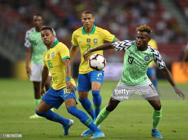 Renan Lodi of Brazil and Samuel Chukwueze of Nigeria challenges for the ball during the international friendly match between Brazil and Nigeria at...