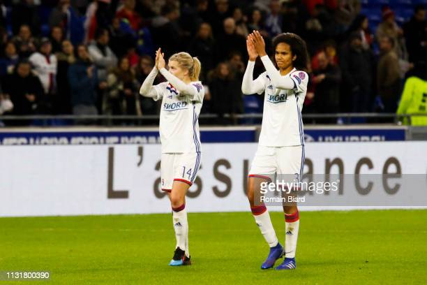 Renard Wendie of Lyon and Hegerberg Ada of Lyon salutes the crowd during the Women's Champions League match between Lyon and Wolfsburg on March 20...