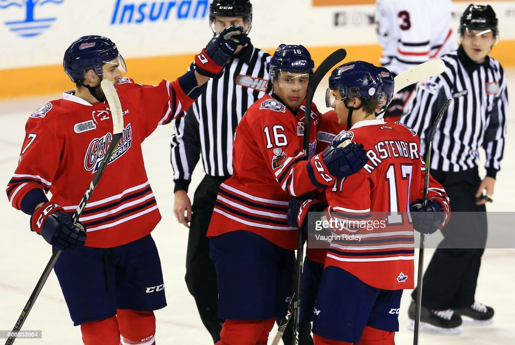 Renars Krastenbergs #17 of the Oshawa Generals celebrates a goal with Alex Di Carlo #37 and Riley Stillman #16 during the first period of an OHL game against the Niagara IceDogs at the Meridian Centre on October 26, 2017 in St Catharines, Ontario, Canada.