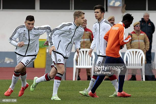 Renat Dadachov Arne Maier and Nikola Kosanic of Germany get prepared for the kickoff while both teams greet each during the U16 UEFA development...