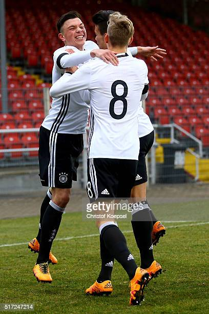 Renat Dadachov of Germany celebrates the first goal with Arne Maier and Atakan Akkaynak during the U17 Euro Qualification match between Germany and...