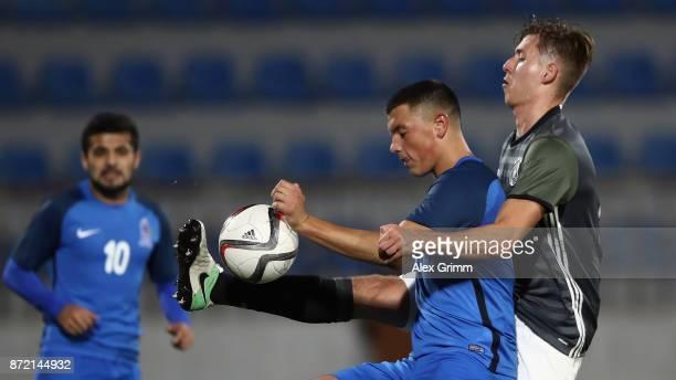 Renat Dadashov of Azerbaijan is challenged by Waldemar Anton of Germany during the UEFA Under21 Euro 2019 Qualifier match between Azerbaijan U21 and...