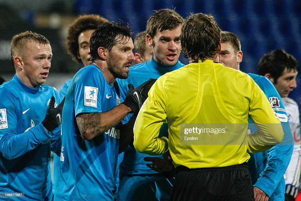 Renat Yanbaev, Miguel Danny, Nicolas Lombaerts, Igor Denisov of FC Zenit St. Petersburg argue with the referee during the Russian Football League Championship match between FC Zenit St. Petersburg and PFC CSKA Moscow at the Petrovsky Stadium on November 26, 2012 in St. Petersburg, Russia.