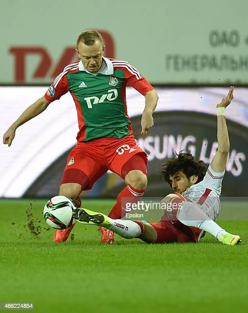 Renat Yanbayev of FC Lokomotiv Moscow challenged by Anri Khagush of Arsenal Tula during the Russian Premier League match between FC Lokomotiv Moscow...