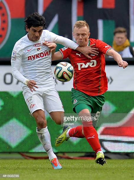 Renat Yanbayev of FC Lokomotiv Moscow challenged by Tino Costa of FC Spartak Moscow during the Russian Premier League match between FC Lokomotiv...