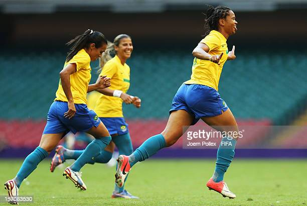 Renata Costa of Brazil celebrates with her team mates afer scoring her team's second goal during Women's Group E match between Cameroon and Brazil on...