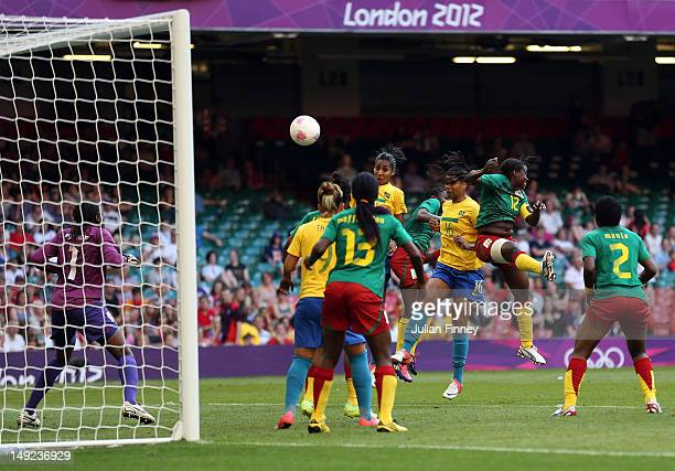 Renata Costa of Brazil scores a header during the Women's Football first round Group E Match of the London 2012 Olympic Games between Cameroon and...