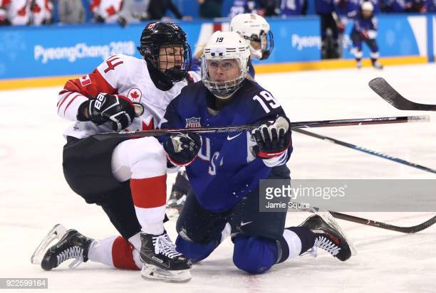 Renata Fast of Canada and Gigi Marvin of the United States get tangled on the ice in the first period during the Women's Gold Medal Game on day...