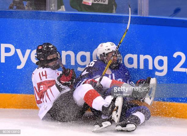 Renata Fast of Canada and Kendall Coyne of the United States fall on the ice in the second period during the Women's Gold Medal Game on day thirteen...
