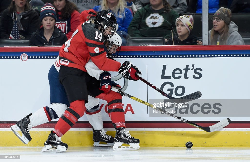 Renata Fast #14 of Canada and Kendall Coyne #26 of the United States go after the puck during the first period of the game on December 3, 2017 at Xcel Energy Center in St Paul, Minnesota.