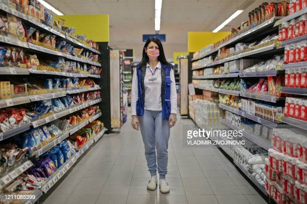 Renata Gajic who works at a supermarket, poses for a picture in Mladenovac, Serbia, on April 21, 2020 during the COVID-19 coronavirus pandemic. -...