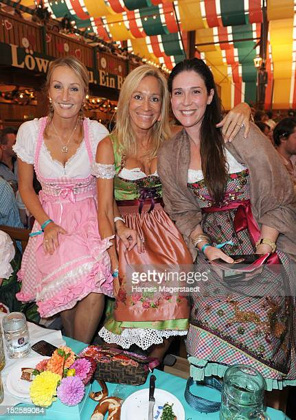 Renata Kochta Pilar Brehme and Nathalie Countess von Bismarck attend the Tiffany Wiesn at the Schuetzenzelt during the Oktoberfest beer festival at...