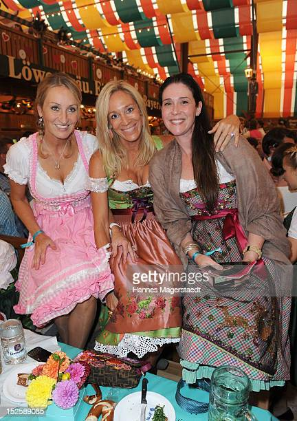 Renata Kochta Pilar Brehme and Nathalie Countess von Bismarck attends the Tiffany Wiesn at the Schuetzenzelt during the Oktoberfest beer festival at...