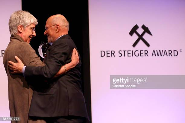 Renate Baehr hands out the charity award to entrepreneuer Dirk Rossmann during the Steiger Award on at Coal Mine Hansemann Alte Kaue March 25 2017 in...