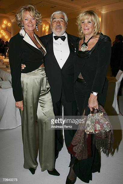 Renate Ganz actor Mario Adorf with wife Monique Adorf attend the German Bundespresseball on November 24 2006 in Berlin Germany