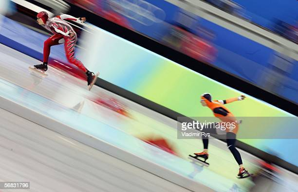 Renate Groenewold of the Netherlands and Cindy Klassen of Canada compete in the women's 3000m speed skating final during Day 2 of the Turin 2006...