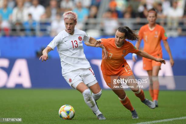 Renate Jansen of the Netherlands battles for possession with Sophie Schmidt of Canada during the 2019 FIFA Women's World Cup France group E match...