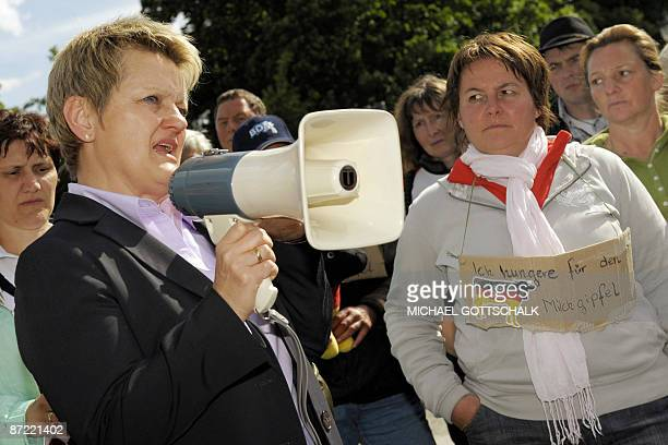 Renate Kuenast coleader of the Green party's Parliamentary Group speaks to dairy farmers staging a hunger strike in front of the Chancellery in...