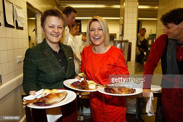 Renate Kuenast of the German Greens Party and singer Jeanette Biedermann serves Christmas goose dinner to homeless and poor people at the 17th annual...