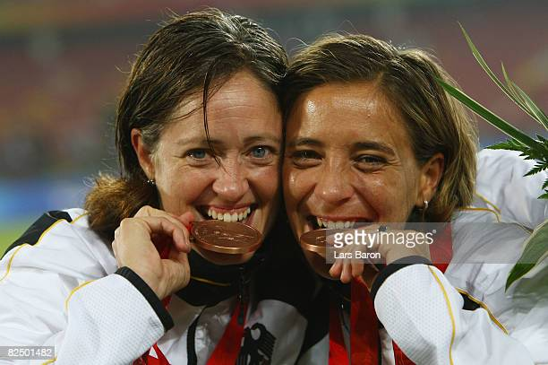 Renate Lingor and Sandra Smisek of Germany pose for the cameras with their Bronze medals for the Women's Football on Day 13 of the Beijing 2008...