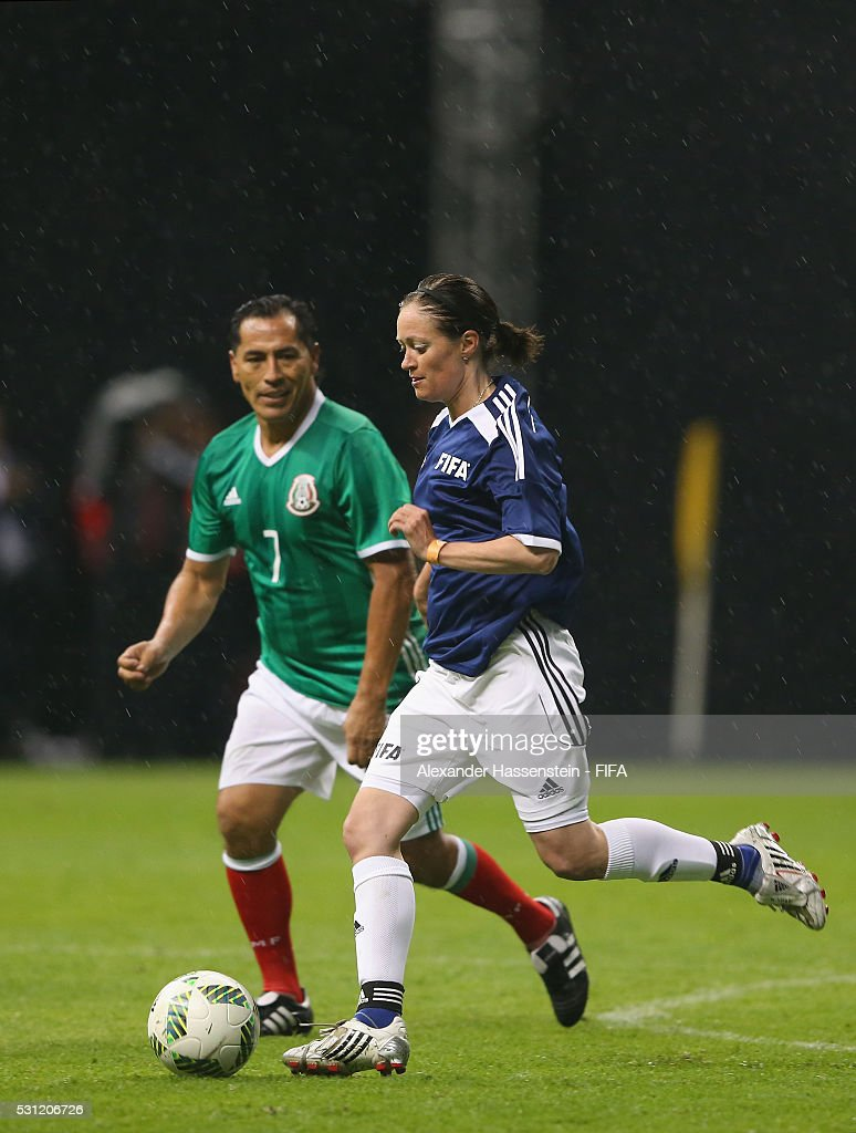 Renate Lingor of FIFA Legends battles for the ball with Benjamin Galindo of MexicanAllstars during an exhibition match between FIFA Legends and MexicanAllstars to celebrate the 50th anniversary of the Azteca stadium ahead of the 66th FIFA Congress at Azteca stadium on May 11, 2016 in Mexico City.