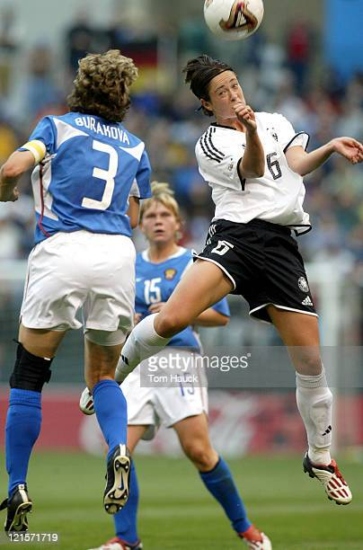 Renate Lingor of Germany heads the ball past Russia's Marina Burakovaduring game action October 2 at PGE Park in Portland Oregon Germany defeated...