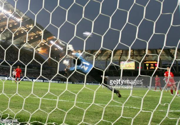 Renate Lingor of Germany scores the second goal and goalkeeper Jon Myong Hui of Korea is chanceless during the Quarter Final Womens World Cup 2007...