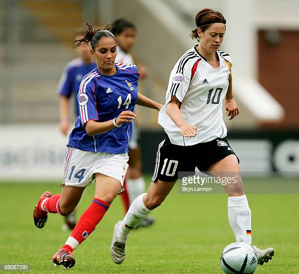 Renate Lingor of Germany slips past Louisa Necib of France during the Women's UEFA European Championship 2005 Group B match between Germany and...