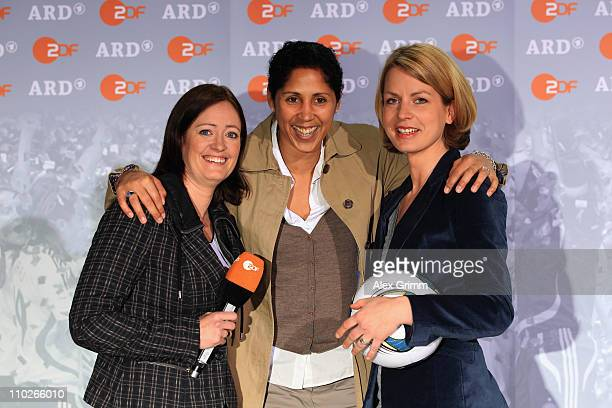 Renate Lingor, Steffi Jones and Jessy Wellmer pose during a photocall with the ARD and ZDF TV presenters for the FIFA Women World Cup 2011 at the...