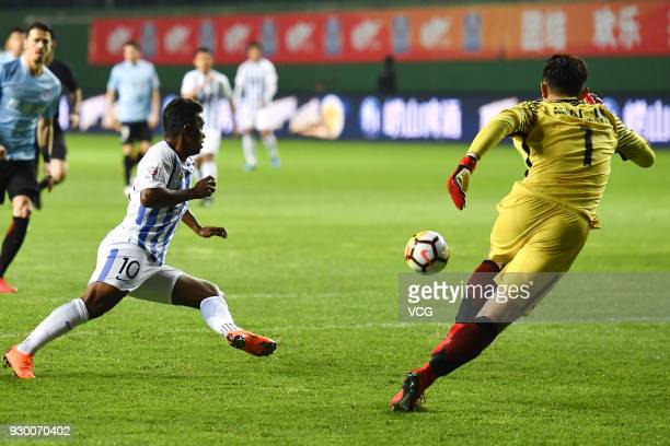 Renatinho of Guangzhou RF and Zhang Chong of Dalian Yifang compete for the ball during the 2018 Chinese Football Association Super League second...