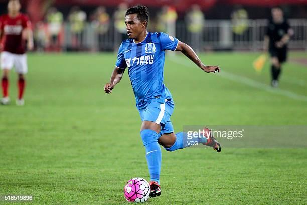 Renatinho of Guangzhou RF drives the ball during the round three match of CSL Chinese Football Association Super League between Guangzhou Evergrande...