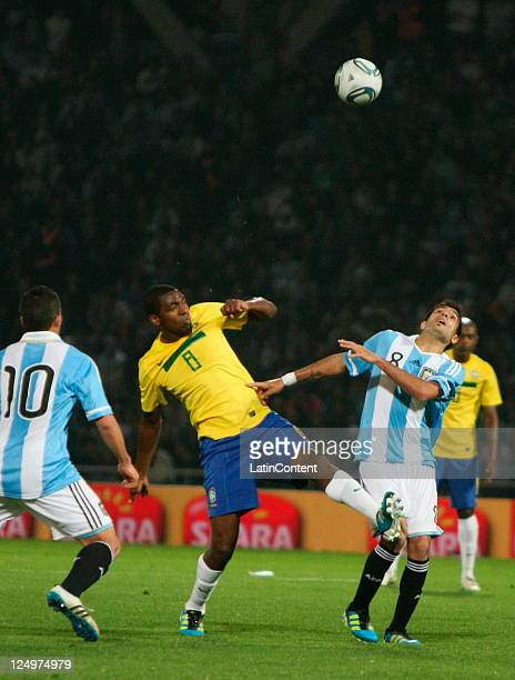 Renato Abreu from Brazil fights for the ball with Augusto Fernández and Héctor Canteros from Argentina during the first match of the Superclasico de...