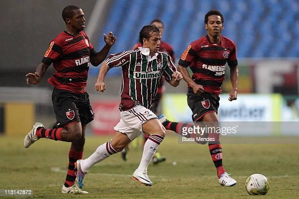 Renato and Fernando of Flamengo struggles for the ball with Diguinho of Fluminense during a match as part Semifinal of Rio de Janeiro State...