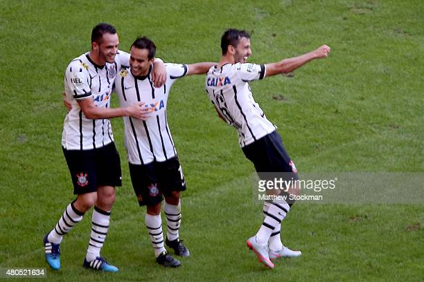Renato Augusto and Jadson of Corinthians congratulate Uendel#6 after his goal against Flamengo during their Brasileirao Series A 2015 match at...